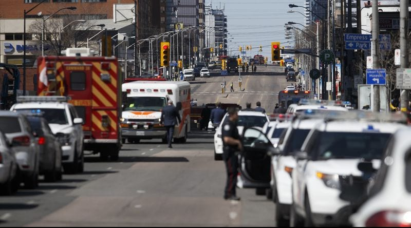 Law enforcement and first responders on scene in downtown Toronto after a van plows into pedestrians on April 23.