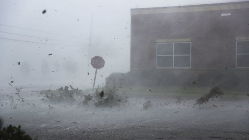 The state on the ground in Florida, as debris is blown down a street by Hurricane Michael in Panama City, Florida