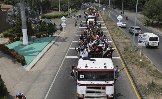 The violence at the border bridges prompted Colombia to order the aid trucks to turn back. Colombian migration authorities also said they would close down the area's four border crossings until Monday