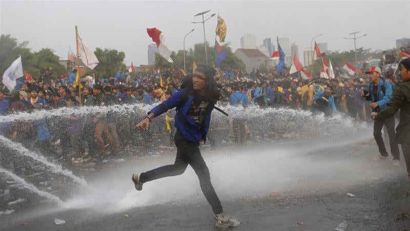 Indonesia protests: police fire tear gas, water cannons as students protest law that would criminalise extramarital sex