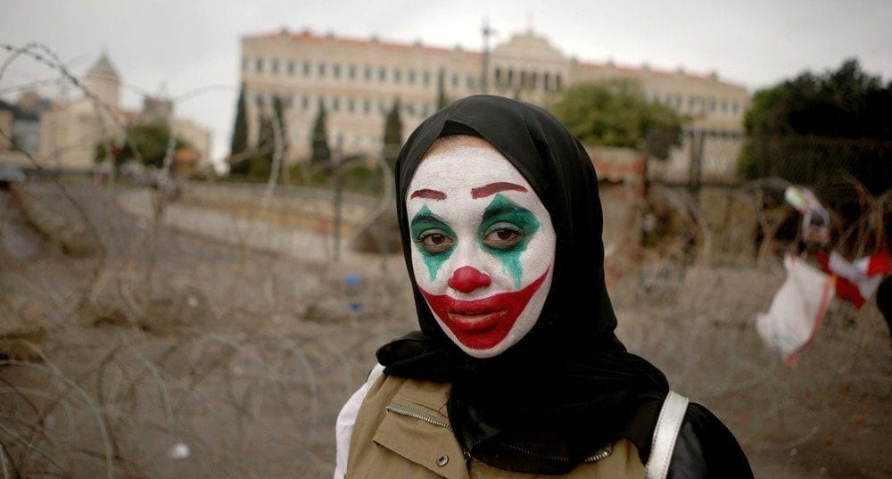 Joker movie make-up and masks have been adopted by protesters worldwide
