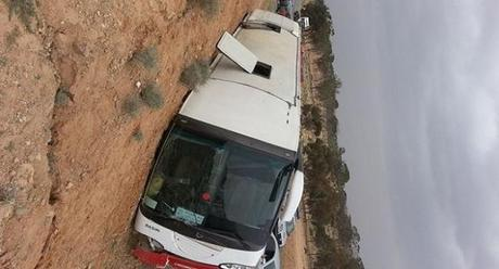A bus carrying Tunisian tourists crashed in the mountains in the country's north on Sunday, killing 22 people and injuring 21