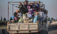 people fleeing bombing in syria