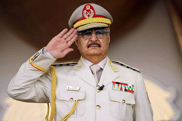 Libyan Khalifa Haftar salutes during a military parade in Benghazi