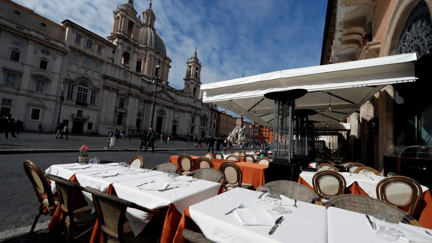 An empty restaurant in Rome's Piazza Navona square - The impact of global recession coming our way