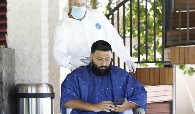 DJ Khaled in lockdown with his wife and child needing a haircut - Well getting one is style