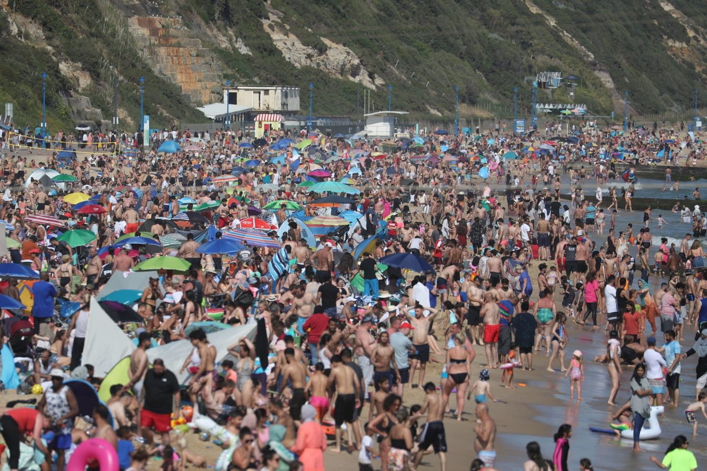 Major incident declared as people flock to England's south coast, Hancock warns he could close beaches