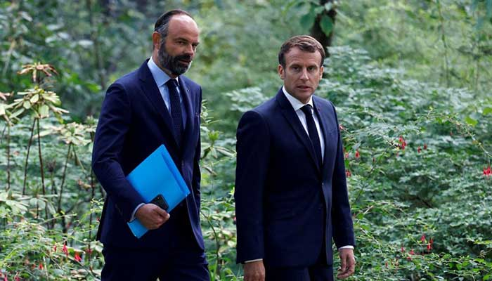 French PM resigns - President Emmanuel Macron and French Prime Minister Edouard Philippe arrive for a meeting with members of the Citizens' Where the French PM hands in his resignation