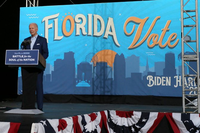 Trump and Biden clash on Covid-19 as they hold rallies in battleground state Florida
