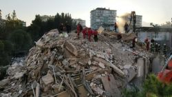 The search for survivors Twenty buildings were turned into mounds of concrete rubble by the earthquake in Izmir