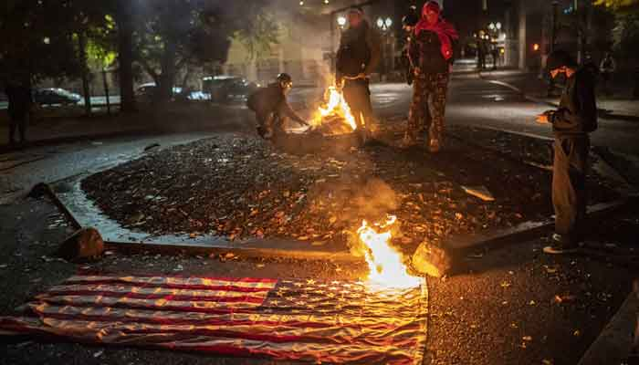 Election Riots in the US - As protesters burn US flags in the US 2020 Election