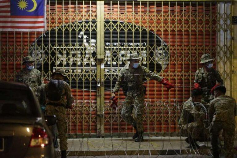 COVID-19 surge creates new headache for beleaguered PM Muhyiddin