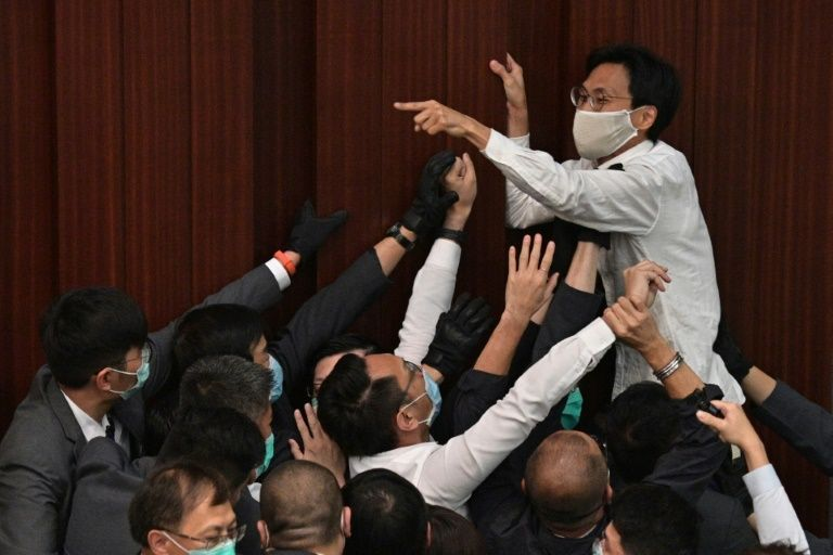 Hong Kong police arrest three ex-lawmakers over May, June protests