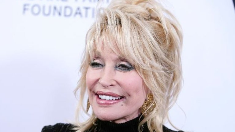 How Dolly Parton is 'playing an important role in Covid battle'