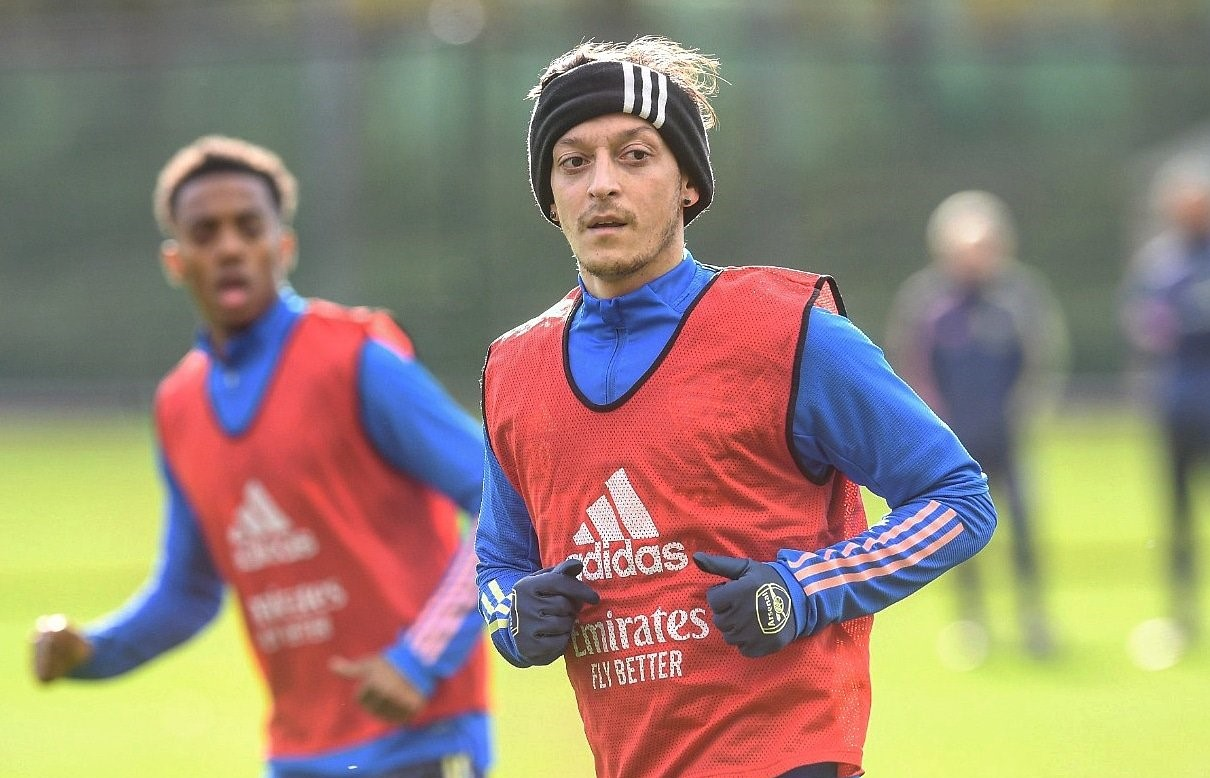 Mesut Ozil is still training for Arsenal despite not being included in the 25-man premier league squad