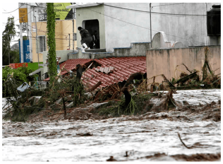 Rain and dam discharge cause flooding in southern Mexico