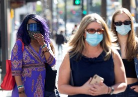 Los Angeles to require mask-wearing indoors again as Covid cases climb