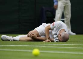 Andy Murray and more stars slip up at wet Wimbledon