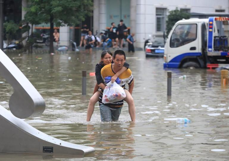 Death toll in China's Henan floods triples to 302, dozens missing