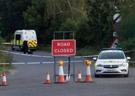Woman's body found at side of road in suspected murder