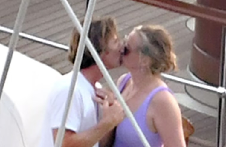 Julia Roberts and husband Daniel Moder kiss aboard a luxury yacht
