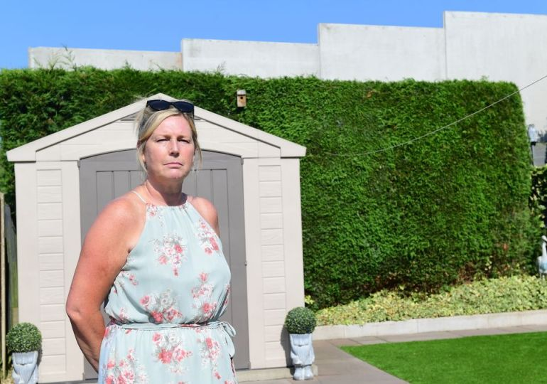 Woman voiced her fury after she comes home to find 20ft wall