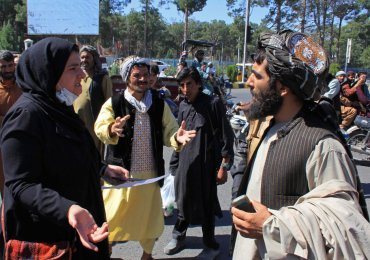 Women in rare protest as Taliban outline new government