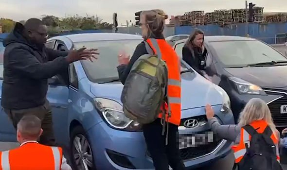 Insulate Britain bring M25 to a halt: Commuters turn violent as eco mob dragged off road