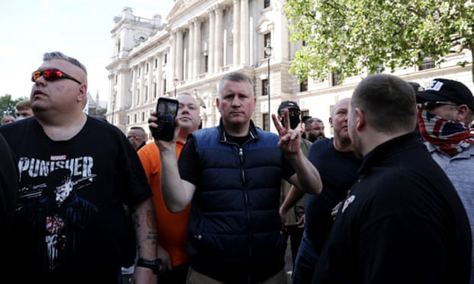 The Britain First far-right thugs antagonise afghan refugees in London lead by, Paul Golding, centre