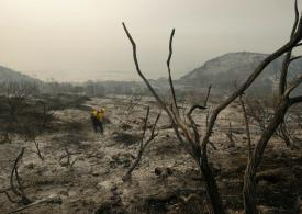 Ranches, homes under threat as wildfire rages in southern California