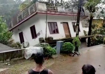 Devastating floods kill at least 22 and washes away houses in India