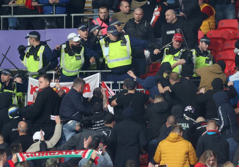 Hungary fans clash with police during World Cup qualifier against England at Wembley