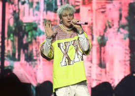 Machine Gun Kelly pelted with bottles and narrowly avoids being hit by tree branch during festival
