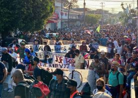 Thousands of migrants march from Mexican city and push past blockade towards US