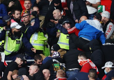 Polish hooligans joined with Hungarian yobs in far-right alliance to viciously attack cops at England match